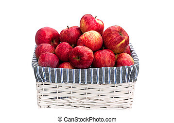 Basket with red apples in summer isolated on white background. Harvest of fresh fruits in the autumn. Delicious apples from the farm for a healthy diet food