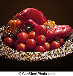 Basket with red bell peppers and cherry tomatoes
