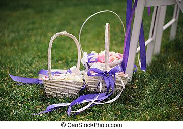 Basket with rose petals. Wedding. Decor.