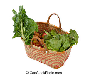 basket with seasonal vegetables on a white background