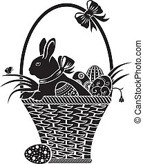 basket with the hare - Easter hare sitting in a basket with...