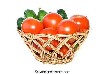 Basket with tomatoes and cucumbers