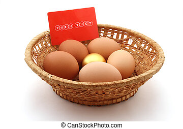 basket with usual chicken egg and golden egg on white background