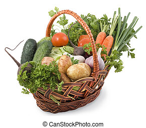 Basket with vegetables isolated on white background.