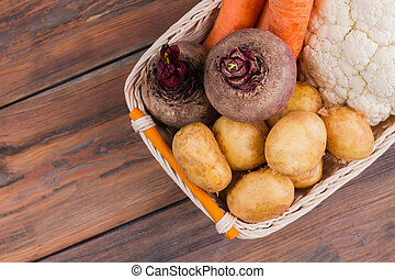 Basket with vegetables on the table.
