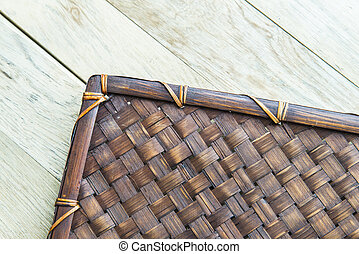 Basket work mat pattern on wooden floor