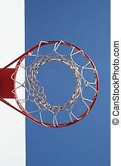 A Basketball Net Displayed against a Blue Sky Creates an Abstract Design.
