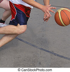 Basketball action - Extreme close-up detail of a street ...