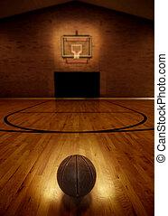 Basketball and Basketball Court - Basketball on floor of...