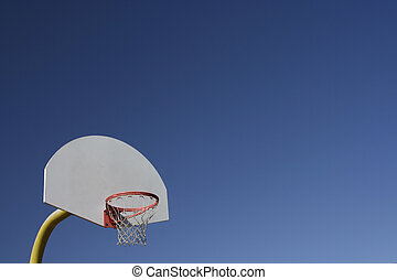 Basketball Backboard and Net on Bright Blue Sky