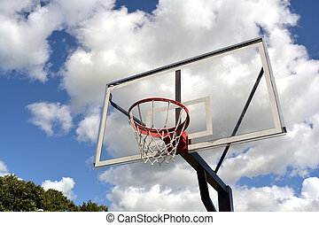 basketball backboard on blue cloudy sky background
