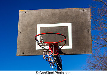 Basketball backboard on blue sky background