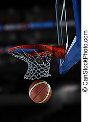 basketball ball and net on black background