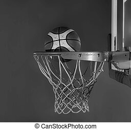 basketball ball and net on grey bac