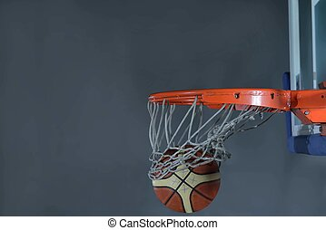 basketball ball and net on grey background