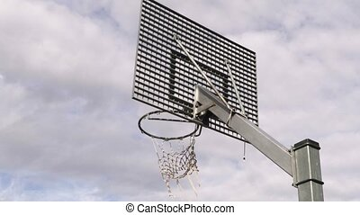 Basketball ball falls in basket