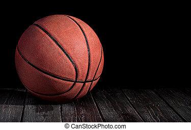 Basketball ball on a wooden floor
