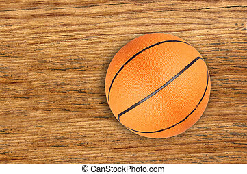 Basketball ball on wooden background