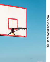 basketball basket against blue sky
