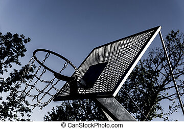 Basketball basket with chains on streetball court.