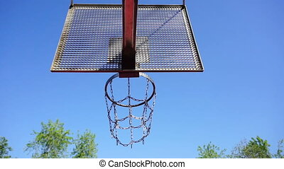 Basketball basket with chains on streetball court
