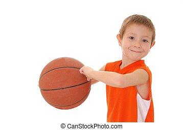Basketball Boy 19 - Young boy playing with a basketball...