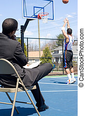 Basketball Coach - A basketball coach in a business suit...