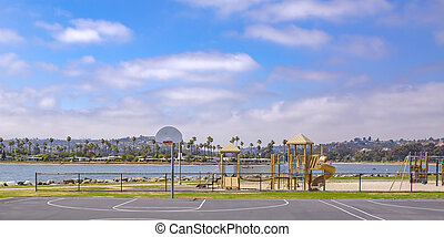 Basketball court in front of a lake in California