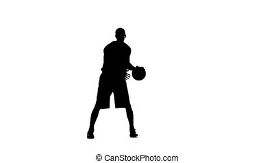 Basketball feint passes the ball. Silhouette. Slow motion. White background.