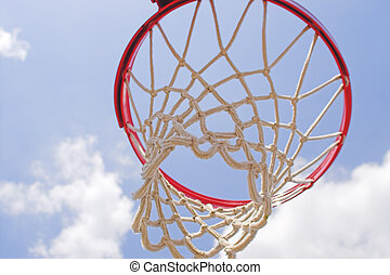 Basketball Goal - A basketball goal wating for a game to...