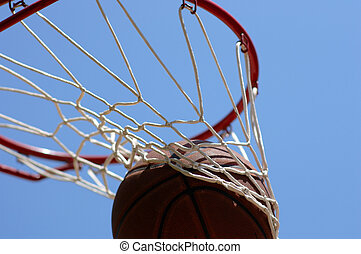 Basketball going through net