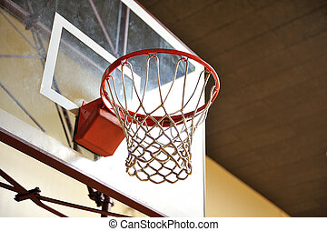 Basketball Hoop - A basketball hoop with a glass backboard...