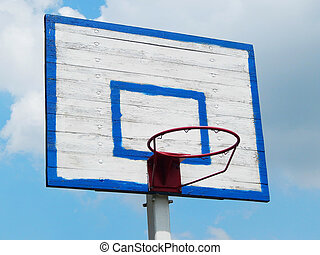 basketball hoop against blue sky horizontal photo.