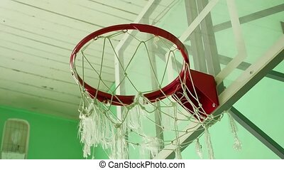 basketball hoop and a billboard in the school gym sport -...