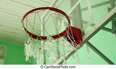 basketball hoop and a billboard in the school sport gym -...