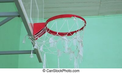 basketball hoop and a billboard sport in the school gym -...