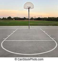 Basketball Hoop - Basketball hoop and court at sunset
