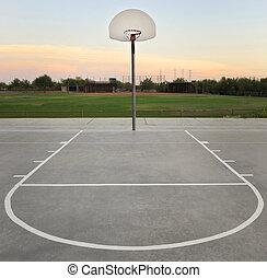Basketball Hoop - Basketball hoop and court at sunset
