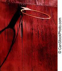 Basketball Hoop - Basketball hoop with red barn wall in the...