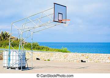 basketball hoop by the sea