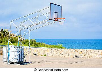 basketball hoop by the sea
