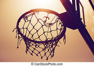 Basketball hoop on amateur outdoor basketball court for...