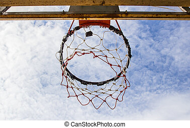 Basketball hoop on sky background