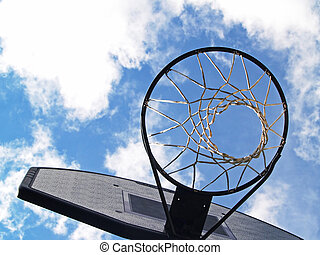 basketball hoop with a cloud-filled blue sky