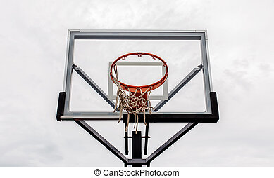 Basketball hoop with sky background
