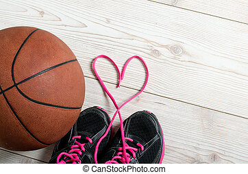 Basketball in heart - Close up of sneakers with lace heart...
