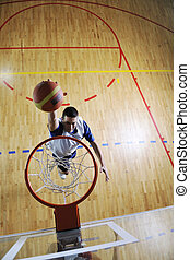 basketball jump - young healthy man play basketball game...