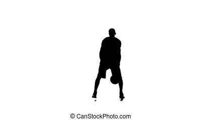 Basketball moves to the side and stuffing the ball. Silhouette