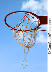 Basketball net against blue sky