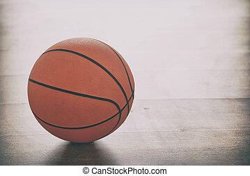 Basketball on wooden floor